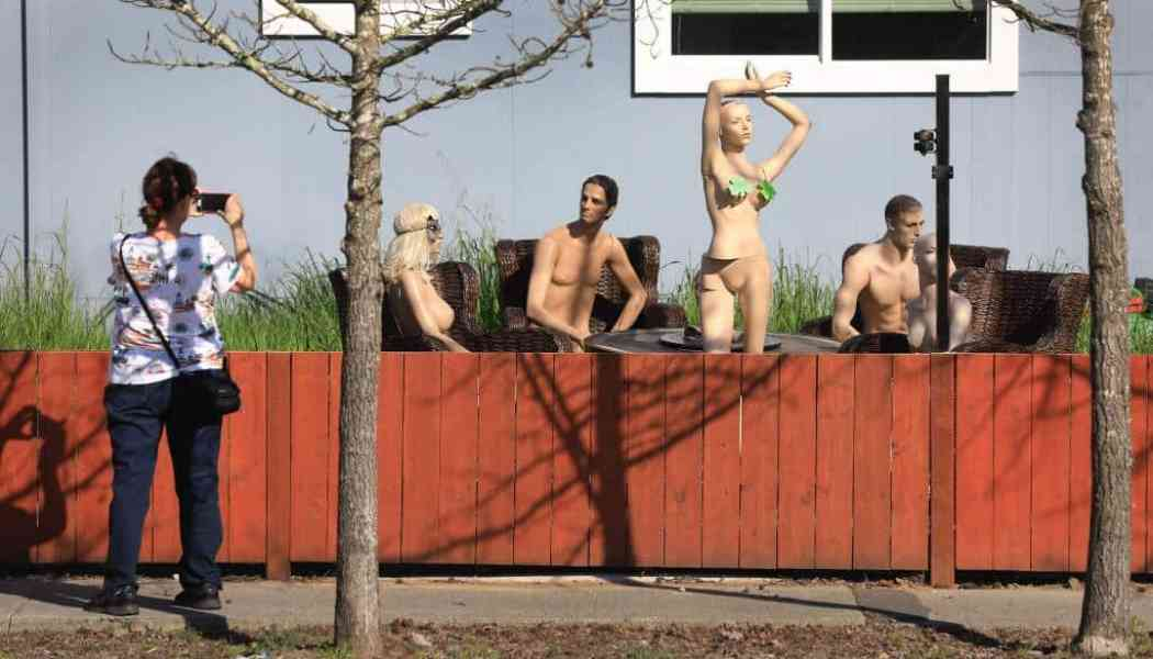 Fence dispute leads to 'naked party' in a front yard